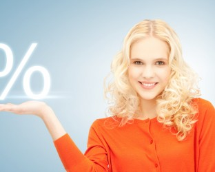 girl showing sign of percent in her hand