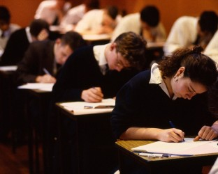 Boys and girls sitting or taking GCSE A Level Examinations.BBEE