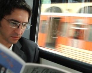 Man-reading-on-train-MP9004051381