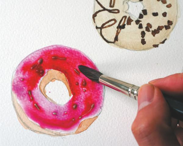 Прелесть этого пончика — в ярком розовом цвете.
